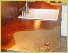 Concrete countertop with custom coloring and exposed aggregate