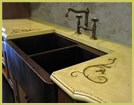 Concrete countertop with custom embeds
