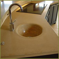 Concrete Farmhouse Sink Is a Natural Fit with Seamless Concrete Kitchen Countertops