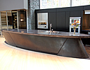 Elliptical shaped modern look concrete countertop